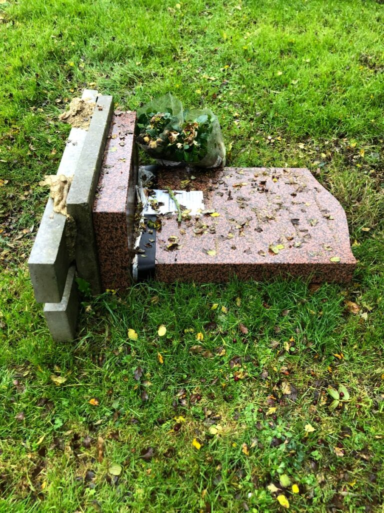 headstone topple test - insurance will cover repair